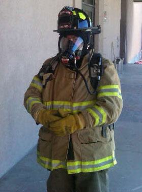 Picture of DJ in full firefighting gear during a training exercise