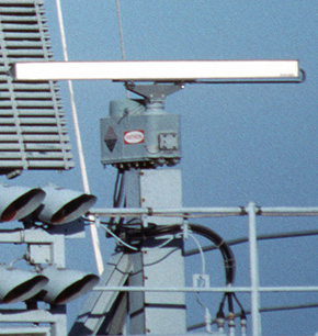 Marine radar slotted array antenna mounted on motor which spins it.