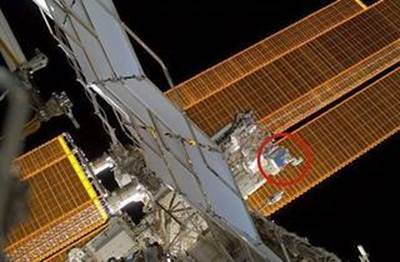 External image of the International Space Station showing SCAN Testbed installed on the nadir side