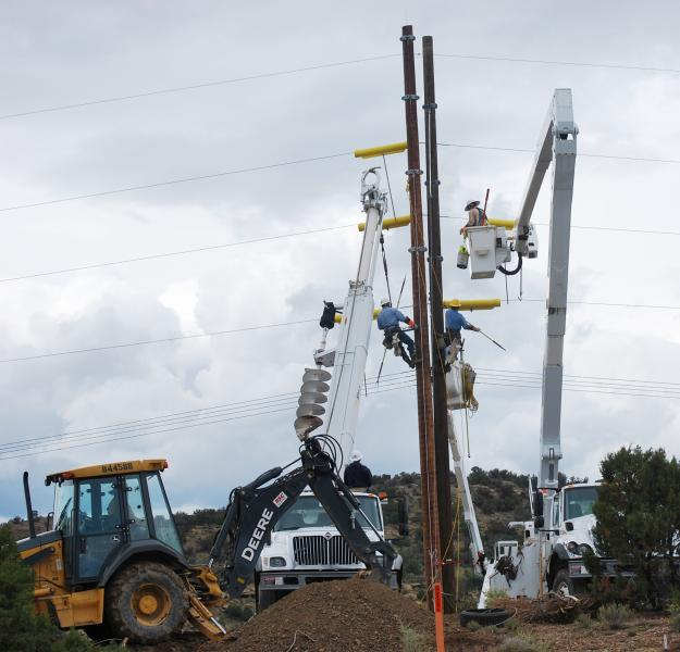 Navajo Tribal Utility Authority construction crews prepare electric infrastructure for installation of fiber-optic cable