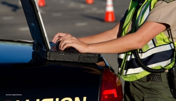 Public safety officer typing on keyboard